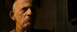 "Cyrus Brunwin (Christopher Lloyd) is confronted in the climax of the nonlinear action thriller ""88."""
