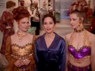 Ebbie (Susan Lucci) is shown Christmases past by perfume counter girls (Jennifer Clement, Nicole Parker) who are supposed to evoke the 1970s here.