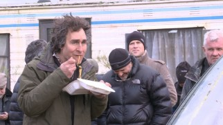 "Director Doug Liman sneaks some noodles in during the production of ""Edge of Tomorrow."""