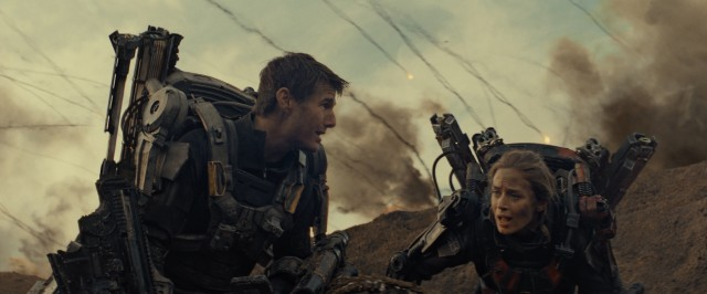 "William Cage (Tom Cruise) and Rita Vrataski (Emily Blunt) pool their efforts to try to defeat an alien slaughter with day-resetting in ""Edge of Tomorrow."""