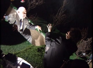 "Tim Burton directs George ""The Animal"" Steele through Tor Johnson's grave sit-up."