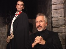 "Make-up artist Rick Baker discusses ""Making Bela"" in front of a life-size Bela Lugosi statue."