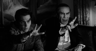 Ed Wood (Johnny Depp) mimics the hand gestures of his new best friend Bela Lugosi (Martin Landau) as they watch a broadcast of one of Lugosi's earlier films.