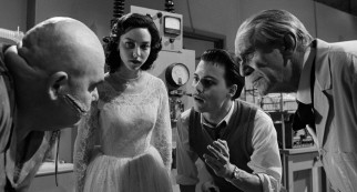"Ed Wood (Johnny Depp) passionately directs Swedish wrestler Tor Johnson (George ""The Animal"" Steele) through the filming of a science lab scene."