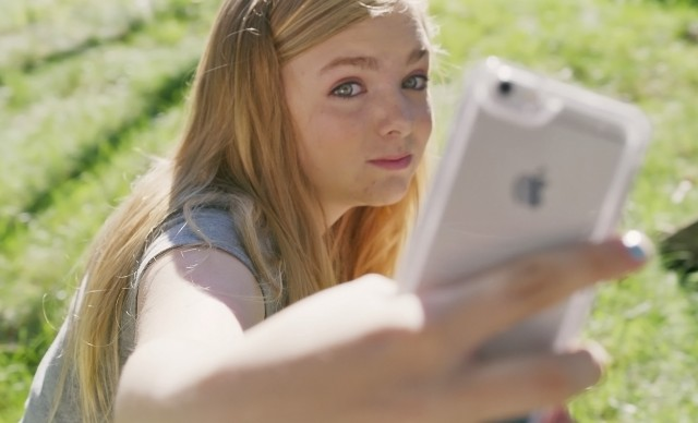 "Kayla Day (Elsie Fisher) snaps a selfie from a flattering high angle in ""Eighth Grade."""