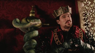 Sir Edgar (Cary Elwes) and his CGI snake sidekick Heston are the film's villains.