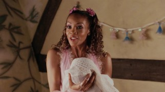Worst gift ever... fairy godmother Lucinda (Vivica A. Fox) bestows upon Ella a curse of obedience.