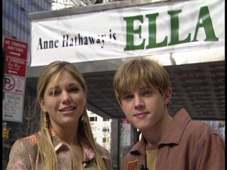 Kari Kimmel and Jesse McCartney host the Ella Enchanted Red Carpet Premiere Special from a New York City sidewalk.