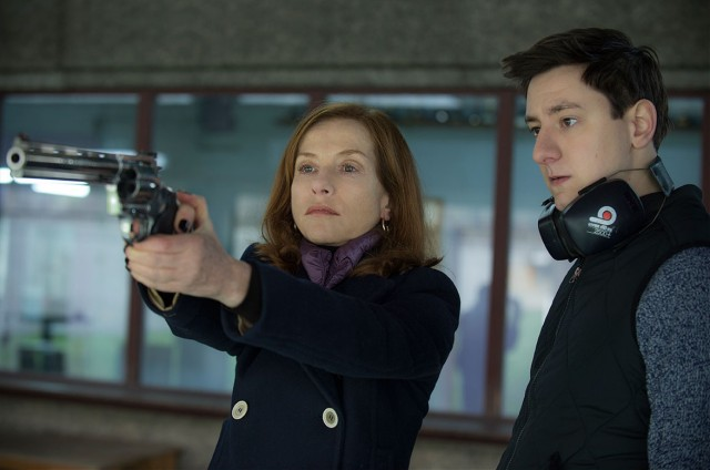 Michèle (Isabelle Huppert) asks an employee to do some hacking and teach her how to shoot.