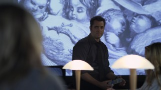 Professor/Coach Cole (Victor Webster) is a big believer in slide projection. It's almost as if he prefers the dark.