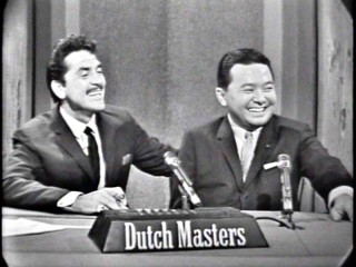 "Ernie Kovacs and mystery guest Daniel Inouye (the future and still U.S. Senator from Hawaii) have a laugh on ""Take a Good Look."""