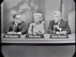 "Ben Alexander, Edie Adams, and Cesar Romero ask questions to figure out the mystery guest of ""Take a Good Look."""