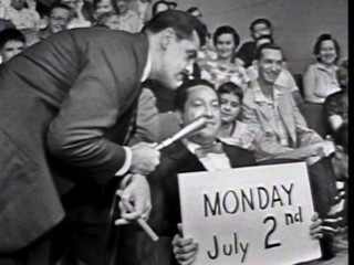 Ernie Kovacs wanders into the crowd attending one of his last morning show tapings and finds several of them promoting his new primetime series' launch.
