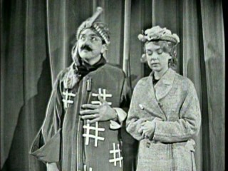 Ernie Kovacs is magician Matzoh Hepplewhite and wife Edie Adams is his assistant/volunteer in this Disc 2 bonus morning show sketch.