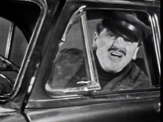 With a false nose, Ernie Kovacs plays a gruff city cab driver in this June 1956 morning show sketch.