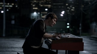 "Piano music by Owl City's Adam Young affects the street lights of this unidentified city in the ""Shooting Star"" music video."