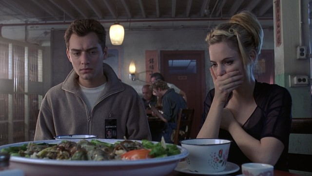 Ted Pikul (Jude Law) and Allegra Geller (Jennifer Jason Leigh) have their regrets about ordering a Chinese restaurant's special.