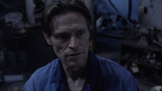 Willem Dafoe plays Gas, a country gas station clerk willing to install an unregistered bioport in Ted's spine.
