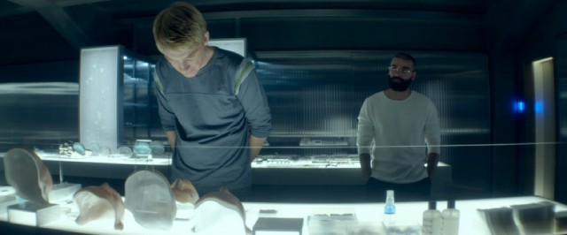 "In ""Ex Machina"", a wealthy, reclusive genius (Oscar Isaac) opens his remote research facility to a young programmer (Domhnall Gleeson)."