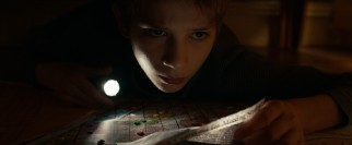 Oskar (Thomas Horn) plots his big adventure in secret, and sometimes in the darkness under his bed.