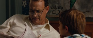 Flashback scenes paint German American jeweler Thomas Schell (Tom Hanks) as the perfect Dad to his son.
