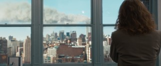 At work, Mrs. Schell (Sandra Bullock) receives a reassuring phone call from her husband while a tasteful, believable visual effect shows the smoky trail of the World Trade Center on the morning of September 11, 2001.