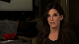 Sandra Bullock notes just how great an actor Tom Hanks is by revealing that he showed up on set to perform his off-camera phone calls with her.