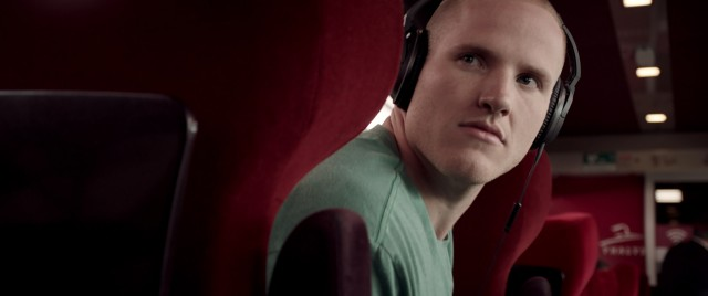 "Spencer Stone (playing himself) sees trouble a brewing aboard ""The 15:17 to Paris."""