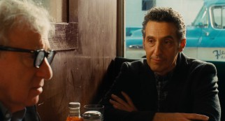 Fioravante (John Turturro) considers his future at a table with Murray (Woody Allen).