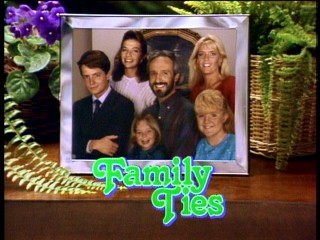 "The Keatons pose for a family photo in the Season Six opening credits of ""Family Ties."""