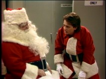 "The apparently real Santa Claus gives mall version Alex (Michael J. Fox) an assist in the heartwarming Christmas episode ""Miracle in Columbus."""