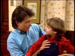 Alex (Michael J. Fox) shares his wisdom with his adoring younger brother Andy (Brian Bonsall).