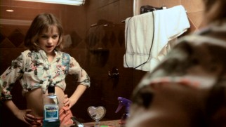 Lucinda (Joey King) tries her Taxi Driver act out in front of the mirror and a bottle of Listerine.