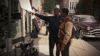 Denzel Washington directs Jovan Adepo in a period-inauthentic Adidas track suit.