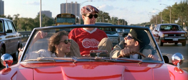 Sloane (Mia Sara), Cameron (Alan Ruck), and Ferris (Matthew Broderick) drive into downtown Chicago for a day off they'll never forget.