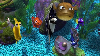 Nemo is embraced by the various colorful fish tank residents.