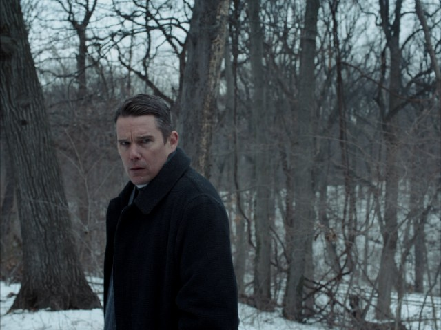 "Ethan Hawke plays the tormented Reverend Ernst Toller in Paul Schrader's acclaimed (#27) ""First Reformed."""