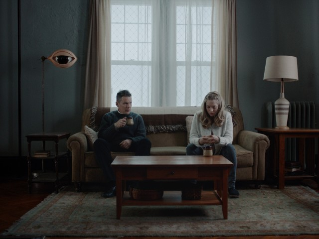 "In ""First Reformed"", Reverend Ernst Toller (Ethan Hawke) counsels troubled parishioner Mary (Amanda Seyfried)."