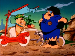 "Fred Flintstone's propensity for speeding repeatedly gets him into trouble in ""Flintstones Little Big League."""