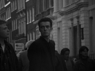 Cobb (Alex Haw) disappears in a crowd in the film's closing shot.
