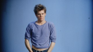 Kevin Bacon tries out the too small sweatshirt look as part of his Costume Montage screen test.