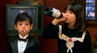 "With a cigarette and champagne, unsupervised kids Juancho (Danny Verduzco) and Sarah (Lana McKissack) live up to the title of their Robert Rodriguez segment, ""The Misbehavers."""