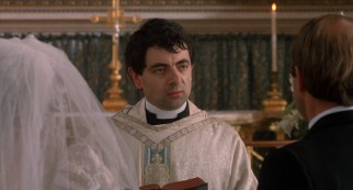 Richard Curtis collaborator Rowan Atkinson appears as nervous, novice Father Gerald, who sweats and stumbles his way through the second wedding's vows.