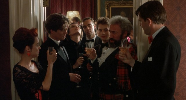 The film's ensemble of seven friends share the screen for a toast at the third wedding, just moments before one of them will suffer a heart attack and die.