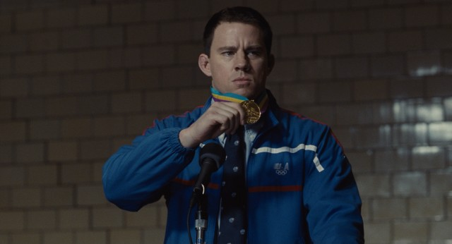"Mark Schultz (Channing Tatum) shows off his Olympic gold medal to grade schooler apathy in ""Foxcatcher."""