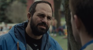 Older brother Dave Schultz (a balding Mark Ruffalo) rejects Mark's offer to join him at Foxcatcher.