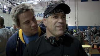 "A blonde frosted Channing Tatum creeps up behind the real Mark Schultz on the set of ""Foxcatcher."""