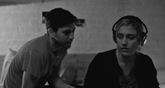 New roommate Benji (Michael Zegen) tries to lift Frances' (Greta Gerwig) spirits with a song she doesn't much like.
