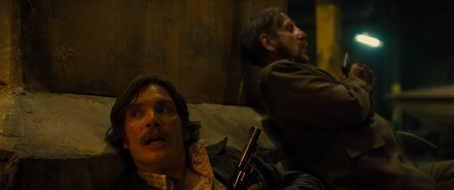 "In ""Free Fire"", 1970s criminals with period-accurate facial hair (including Cillian Murphy and Michael Smiley) crouch and take aim in a Boston warehouse shootout."