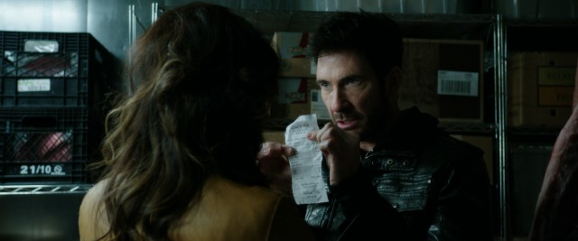 "Robert Saunders (Dylan McDermott) proudly displays the dinner receipt that is supposed to absolve him of all wrongdoing in ""Freezer."""
